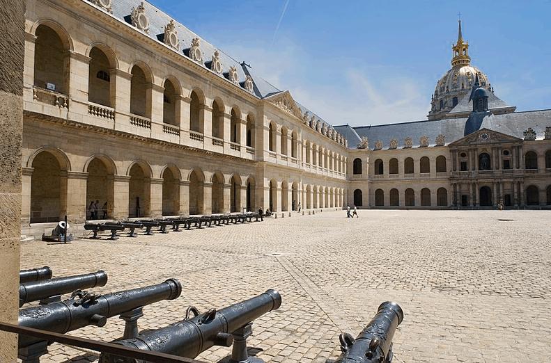 the exterior cobblestone courtyard of Paris' Army Museum, know as the Cour d'honneur