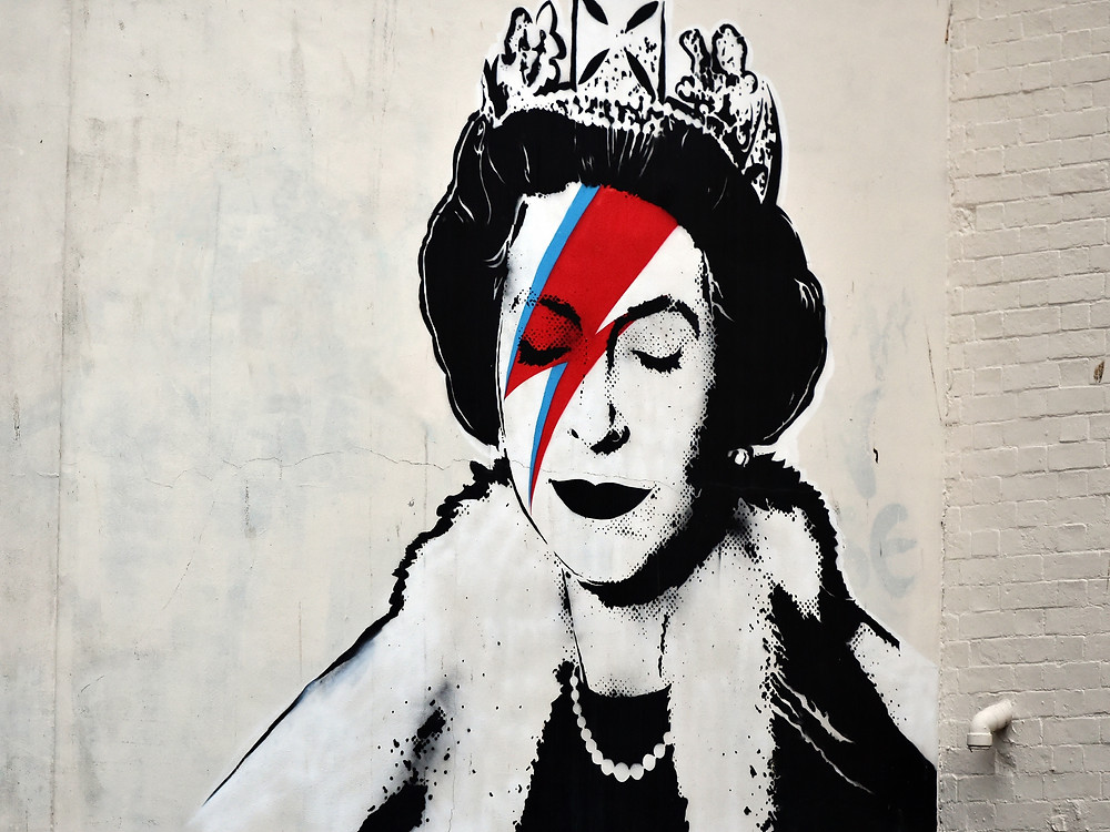 a Banksy piece depicting the Queen as David Bowie in his Ziggy Stardust persona in London