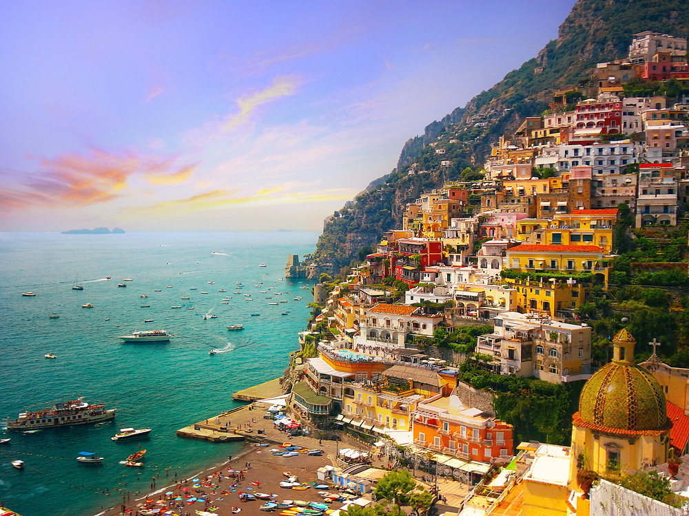 pastel houses cascading down the hills in Positano
