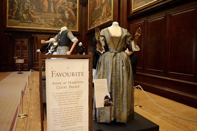 costumes from The Favourite on display in the Cartoon Room of Hampton Court Palace
