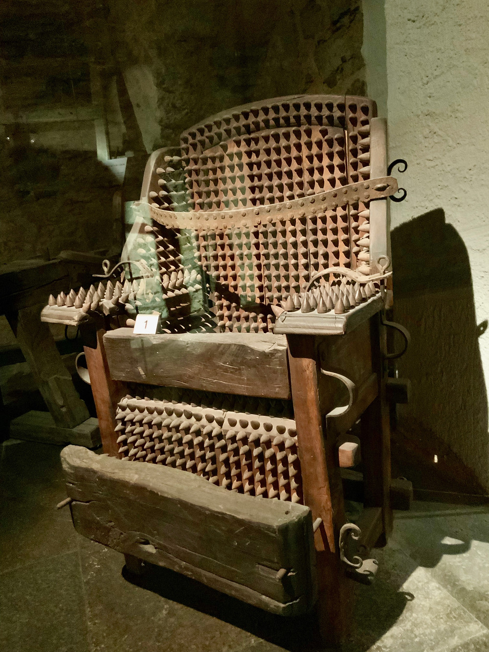 a spikey torture chair in the Rothenburg medieval crime museum
