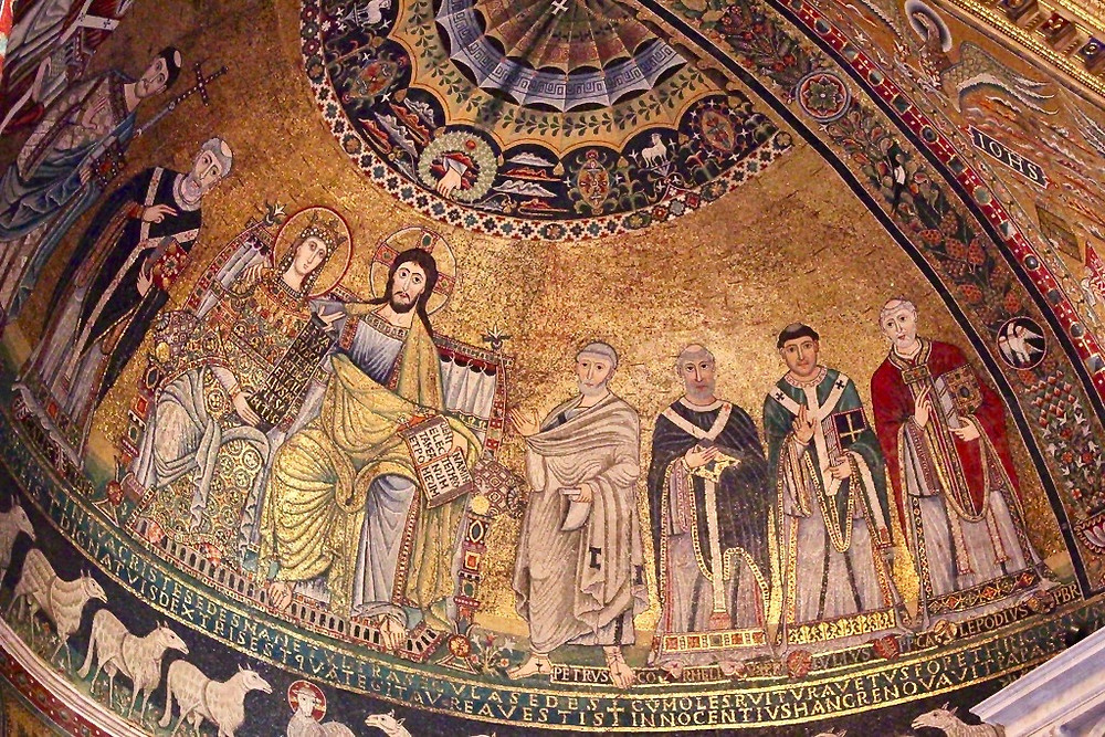 12th century mosaics showing Christ and his mother flanked by saints in the Santa Maria basilica in Trastevere