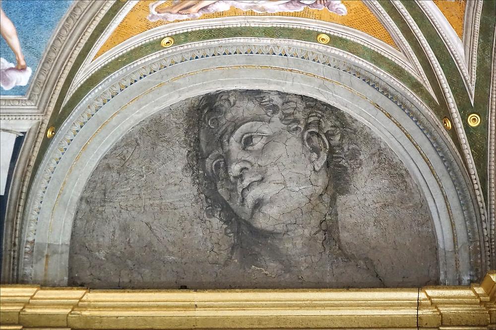 fresco of young man by Peruzzi in the Villa Farnesina
