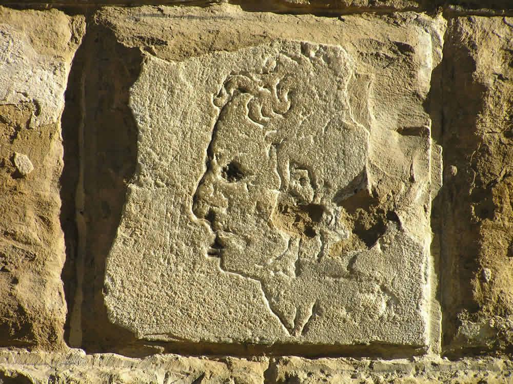 L'importuno di Michelangelo, a carving on the Palazzo Vecchio