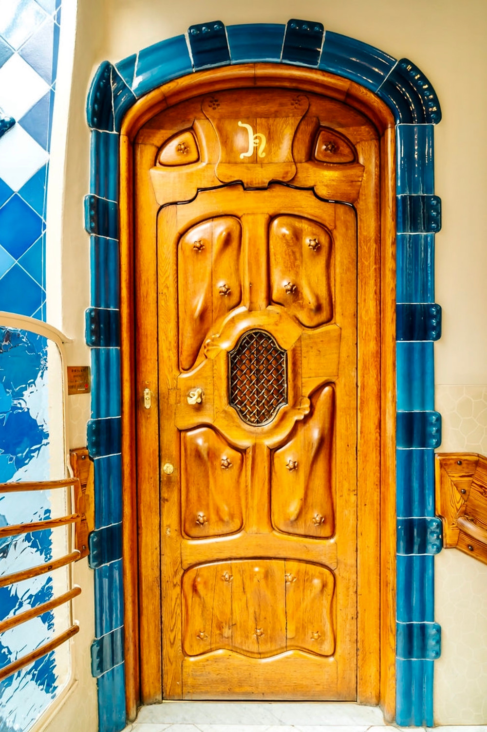 a gorgeous Art Nouveau door on the Noble Floor bordered with a blue tiled arch
