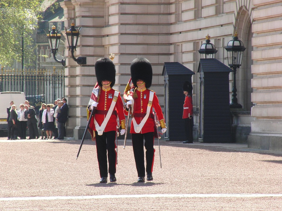 the changing of the guards at Bucking Palace in London