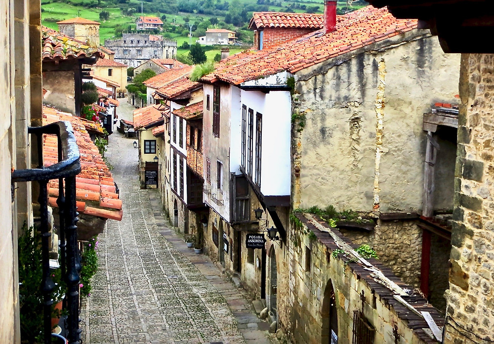 a cobbled lane in the medieval village of Santillana del Mar in Cantabria Spain