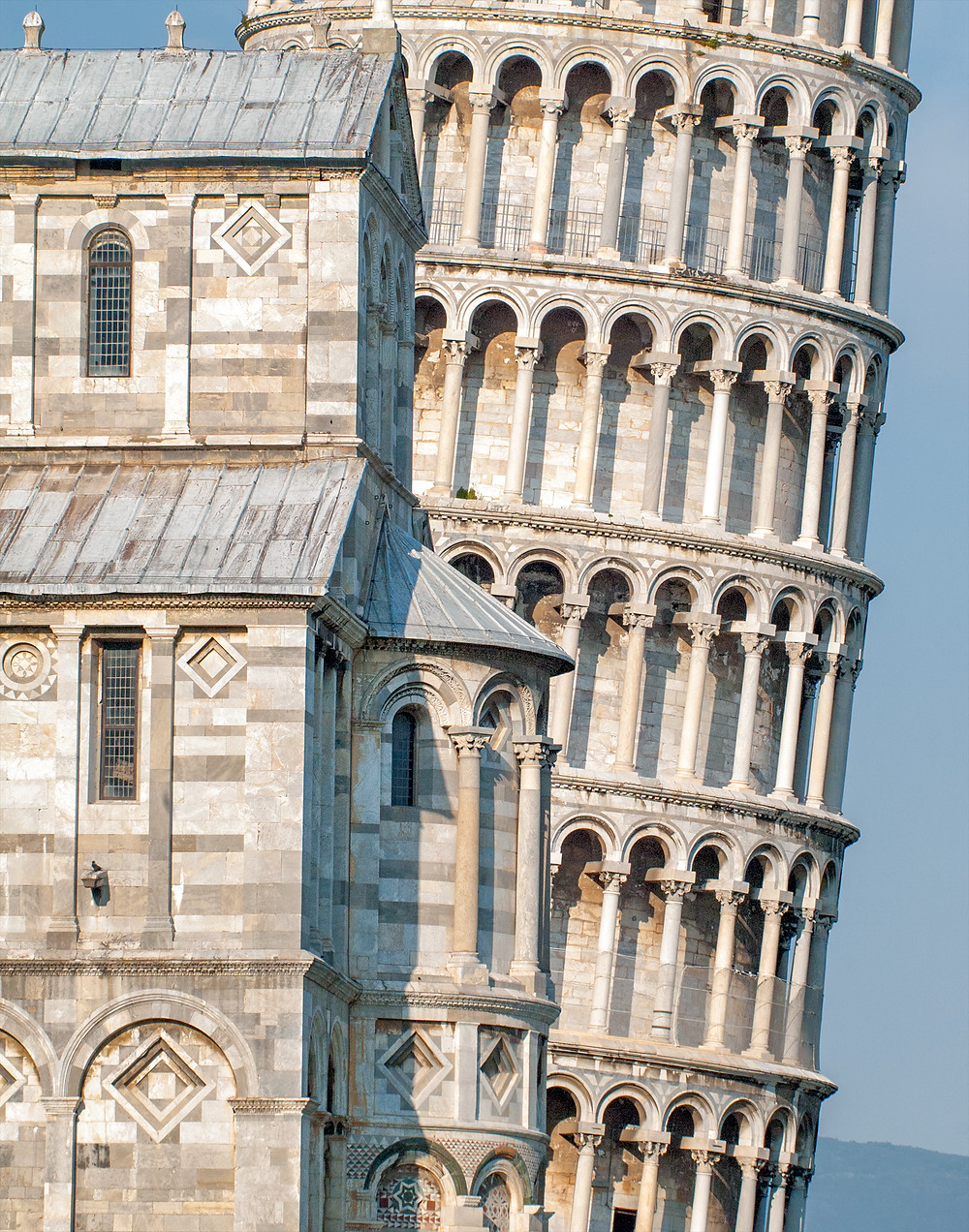 the Leaning Tower of Pisa, peaking out from the right side of the Duomo
