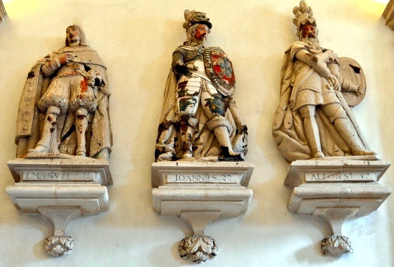 three statues in the King's Hall in Alcobaça Monastery