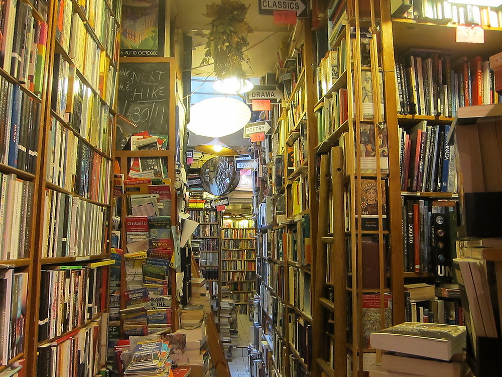 books piled floor to ceiling at Abbey Bookstore
