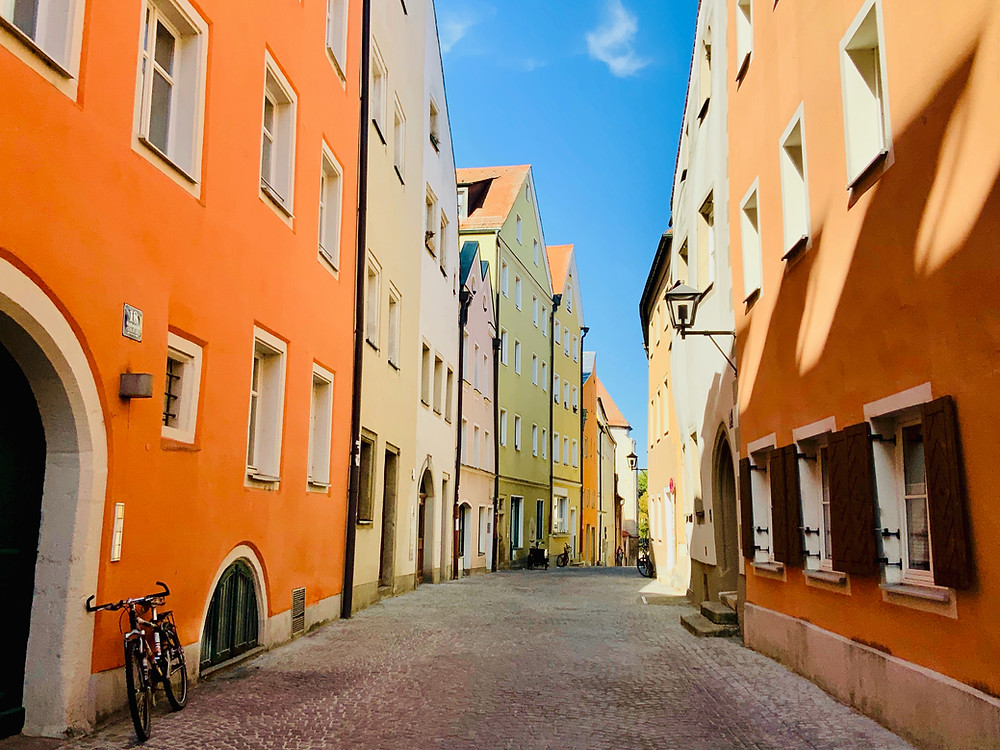 a colorful street in the old town of Regensburg