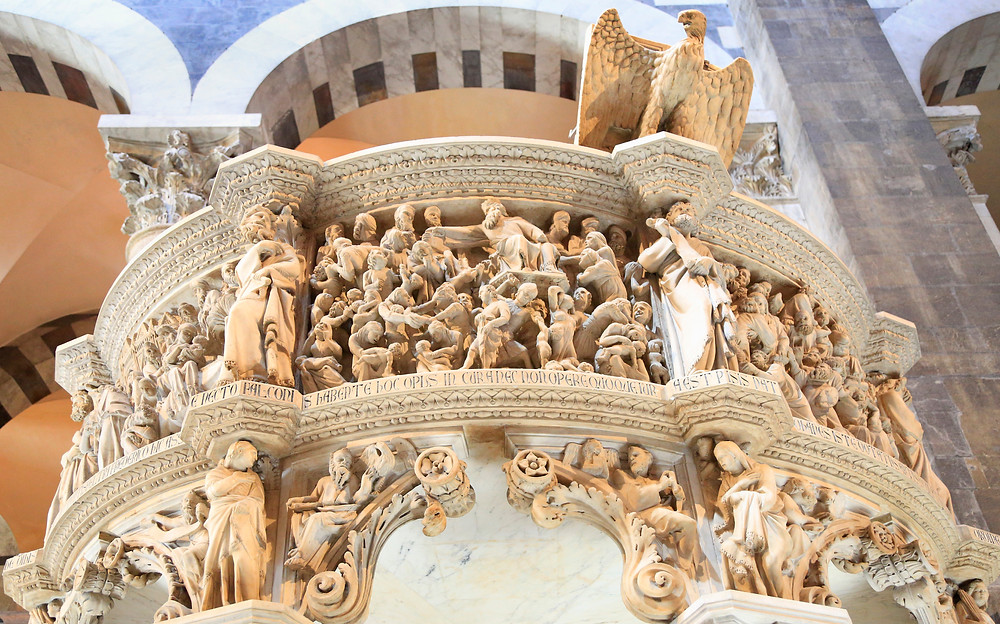 detail of the top of the intricately carved Pisano pulpit in Pisa's Duomo