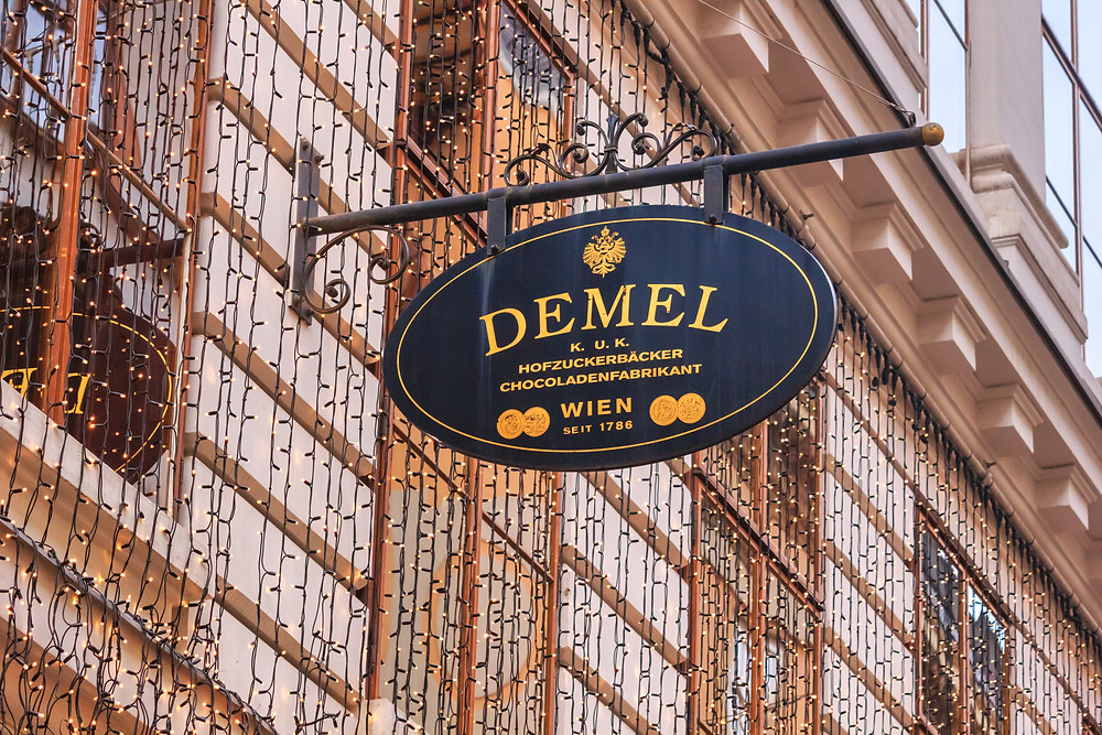 view of the exterior sign cafe Demel on Christmas eve
