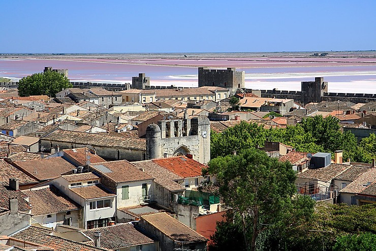 Aigues-Mortes, with its pink salt marshes in the distance