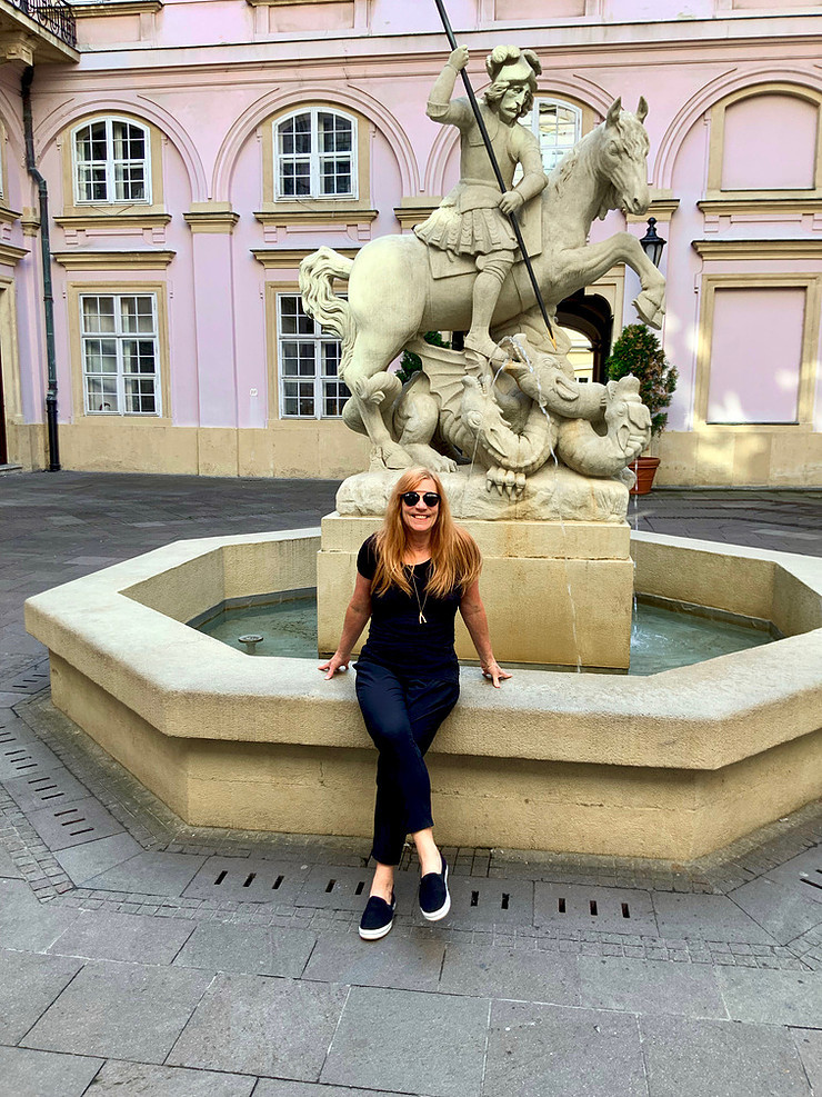 taking a break at the Saint George Fountain in the pretty Primate's Palace courtyard in Bratislava
