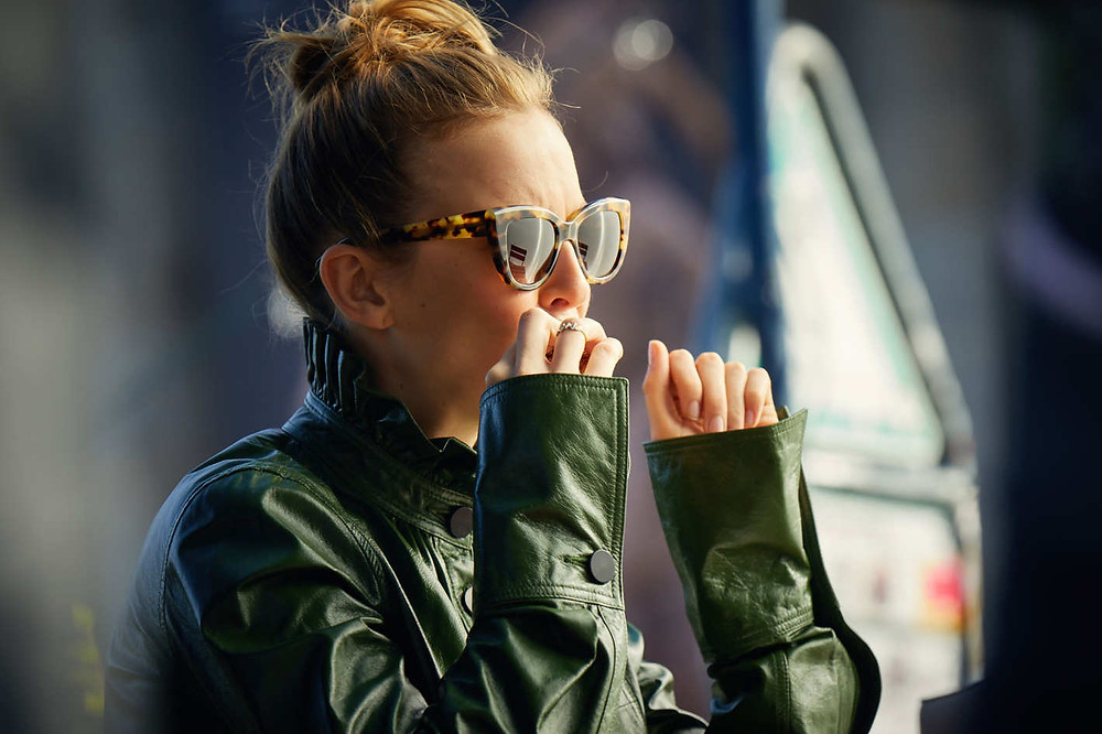 Villanelle spies on Eve, making no attempt to be nondescript in her green ruffle neck leather jacket by JW Anderson