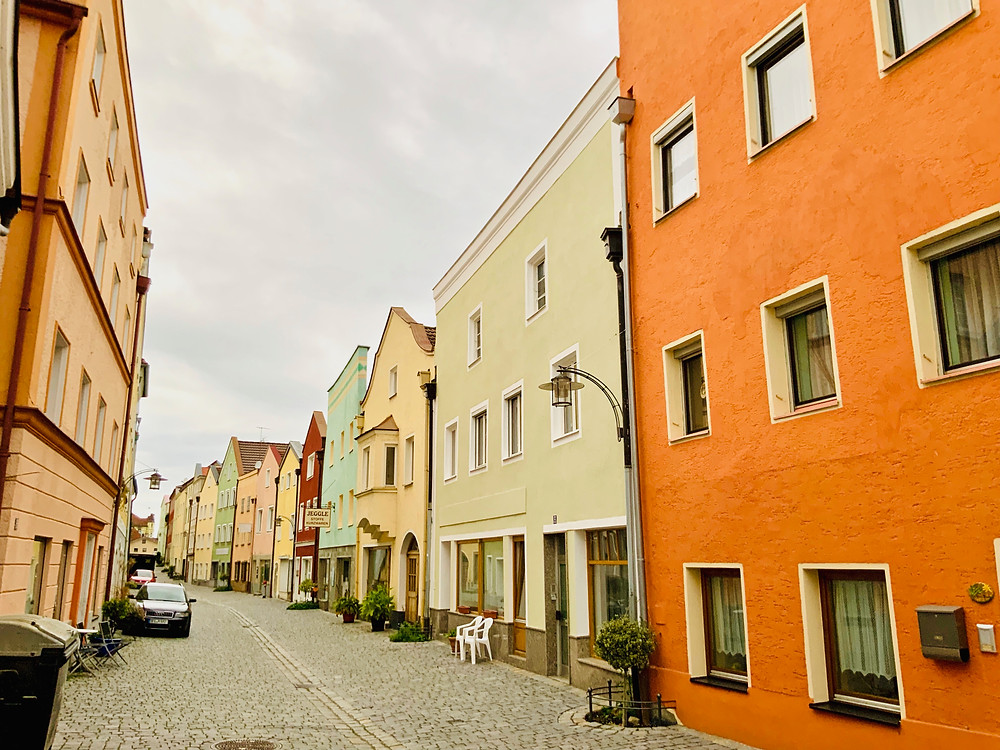 a pretty street with sherbet colored homes in Vilshofen
