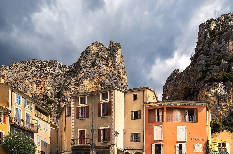 the Provencal town of Moustiers-Sainte-Marie, smushed between two cliffs