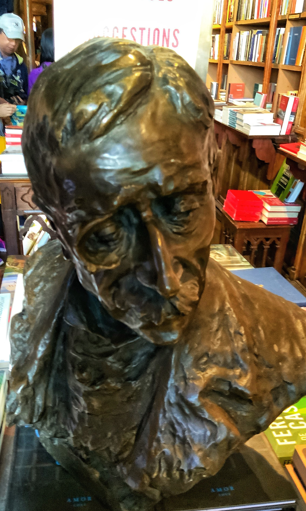 one of the bronze busts of Portuguese writers scattered throughout the bookstore