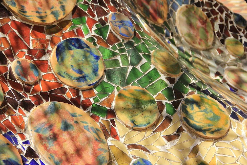 a close up of Gaudi's Trencadís technique on Casa Batlló