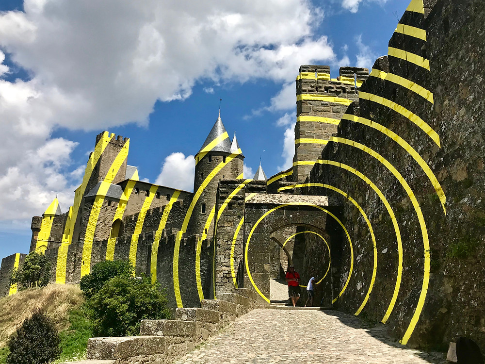 Felice Varini installation seen at the entrance to the old city of Carcassonne