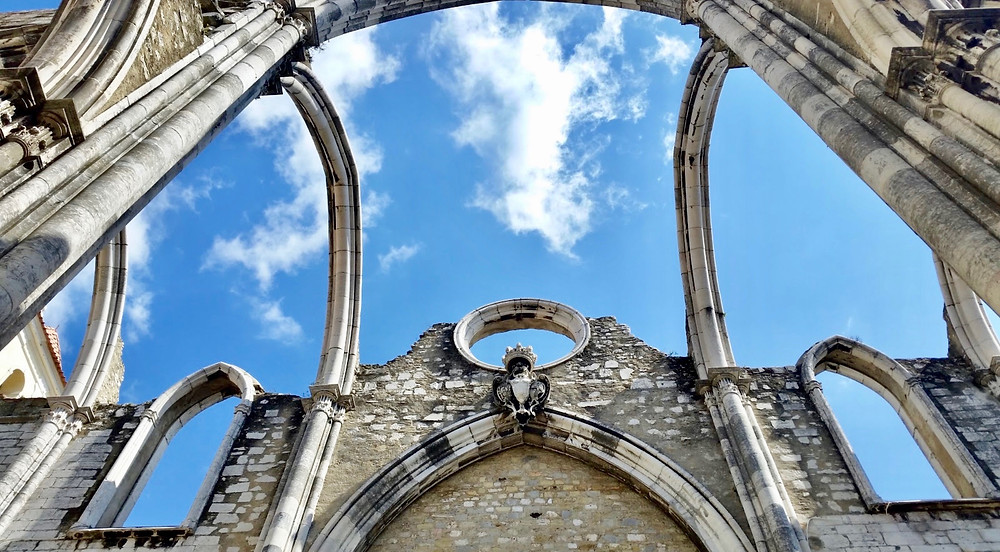 the wishbone-like gothic arches of the Igreja do Carmo set against the blue sky