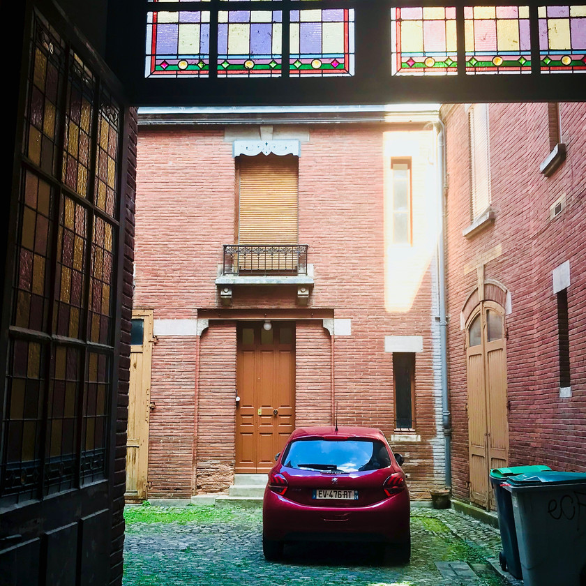 our trusty rental car parked in the courtyard