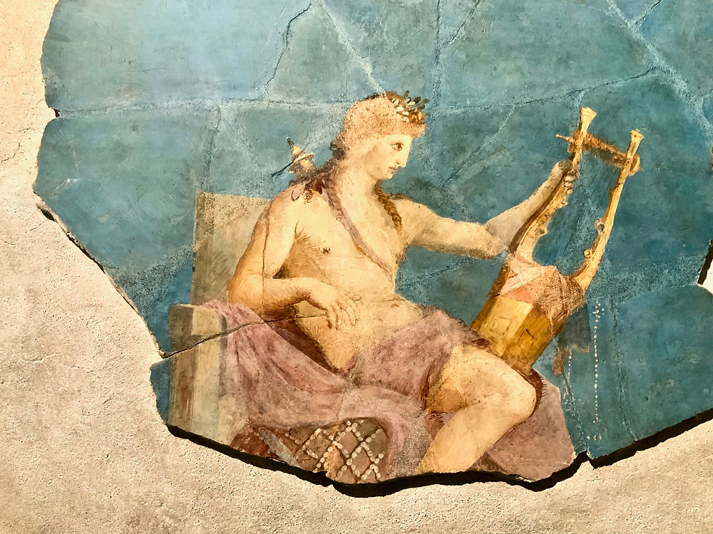 Fragment of a fresco from the House of Augustus in the Palatine Museum. The home had many references to the god Apollo.