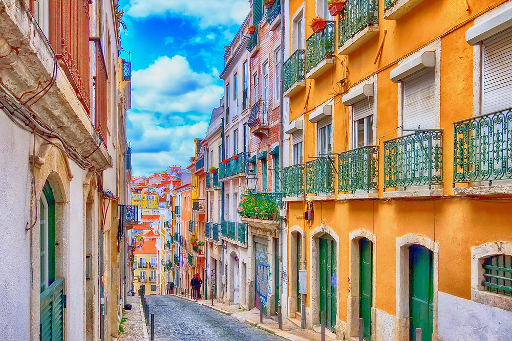 a colorful street in the Alfama neighborhood