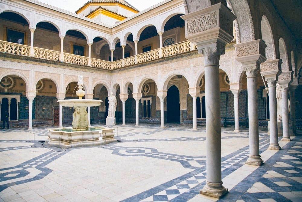 the marble courtyard of the Casa de Pilatos