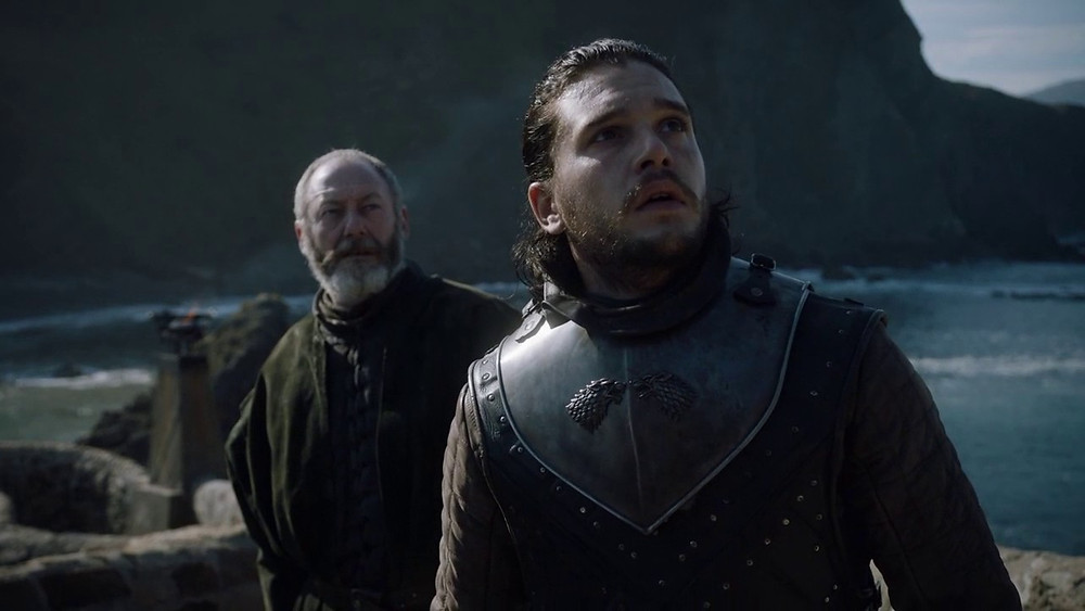 Jon Snow and Sir Davos Seaworth arrive at Dragonstone and see a dragon.