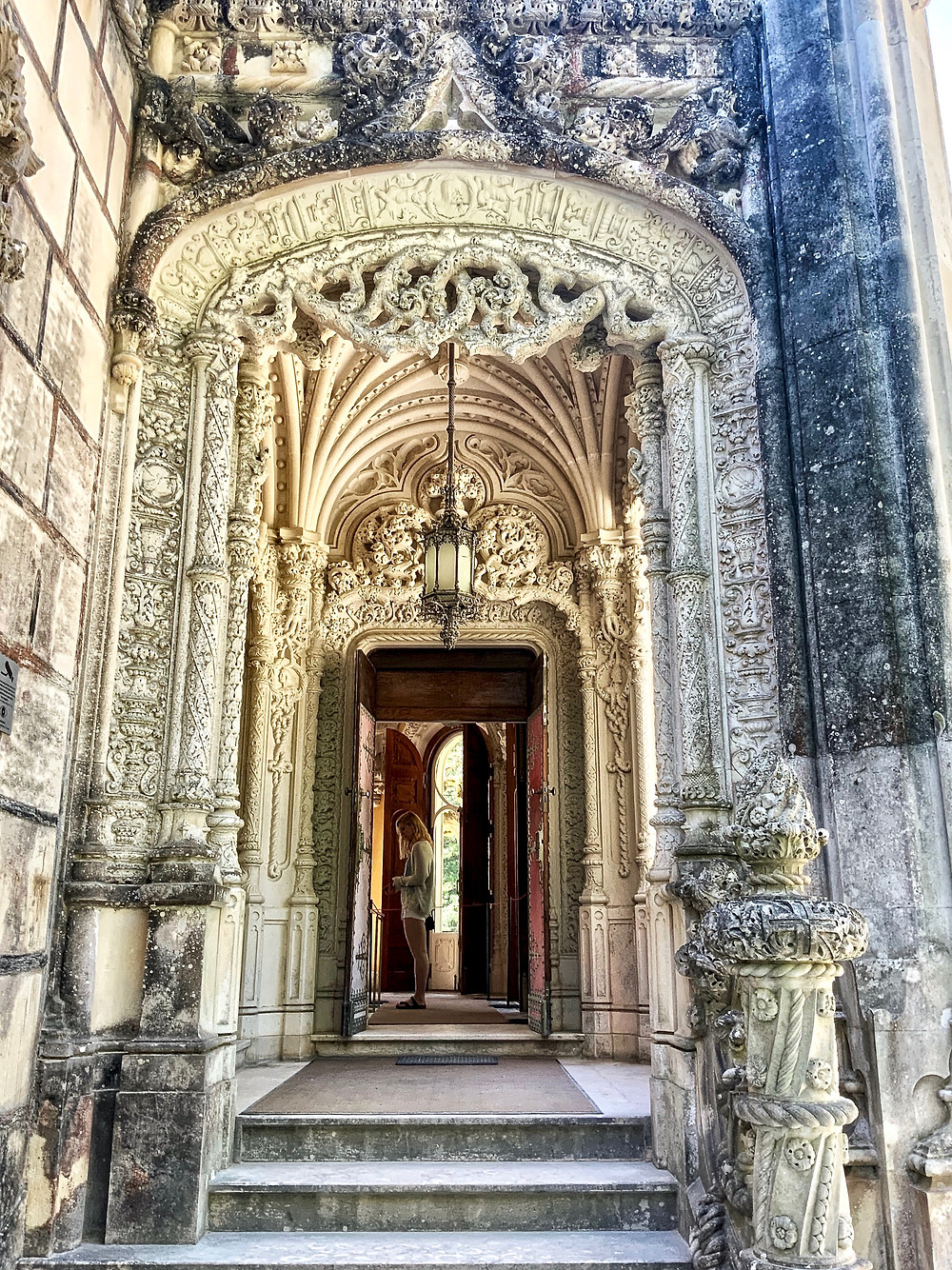 the grand entrance to Quinta de Regaleira palace