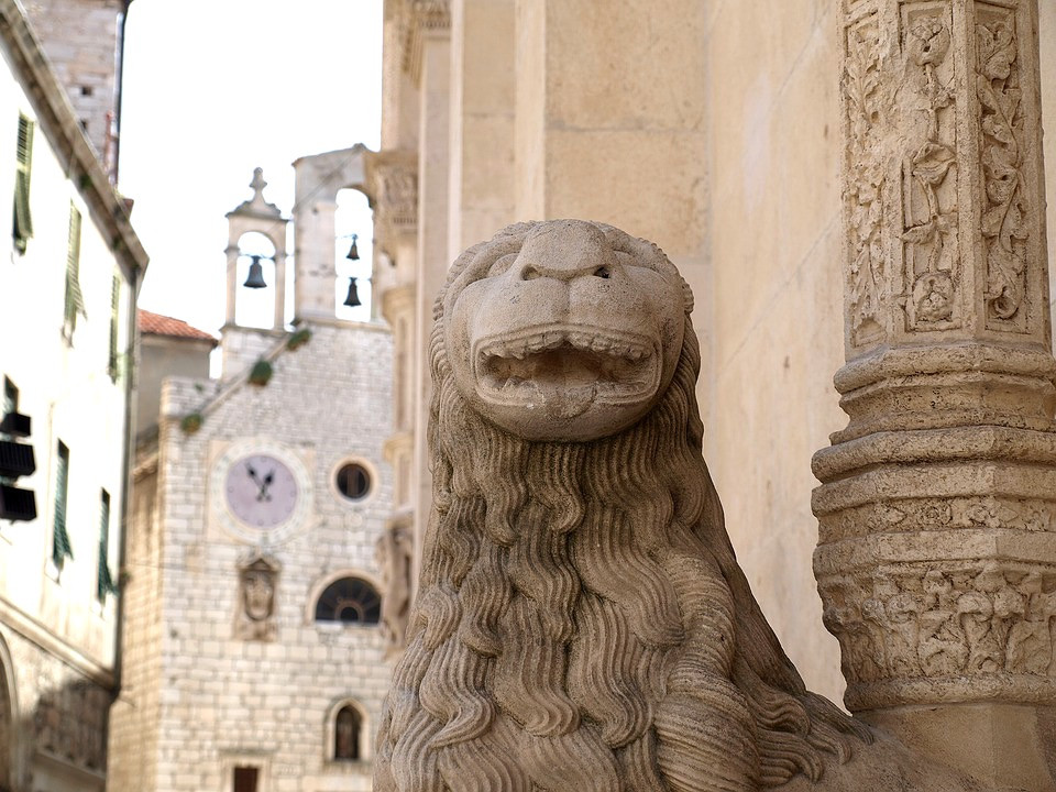 a lion sculpture outside St. James Cathedral in Sibenik