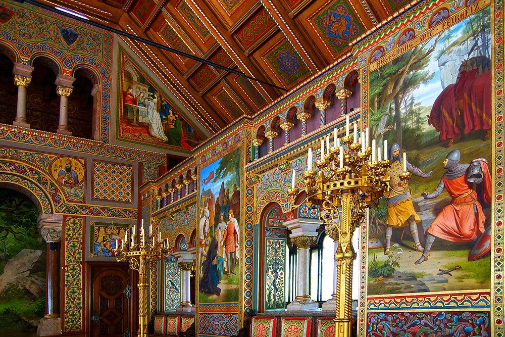 gorgeous walls in Neuschwanstein Palace with paintings of legendary knights