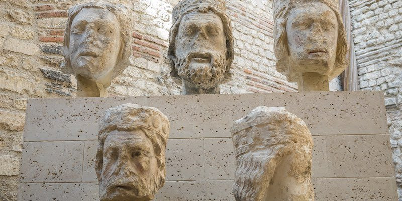stone heads originally on the facade of Notre Dame