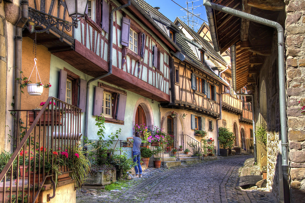 half timbered houses along a cobbled street in a typical French village