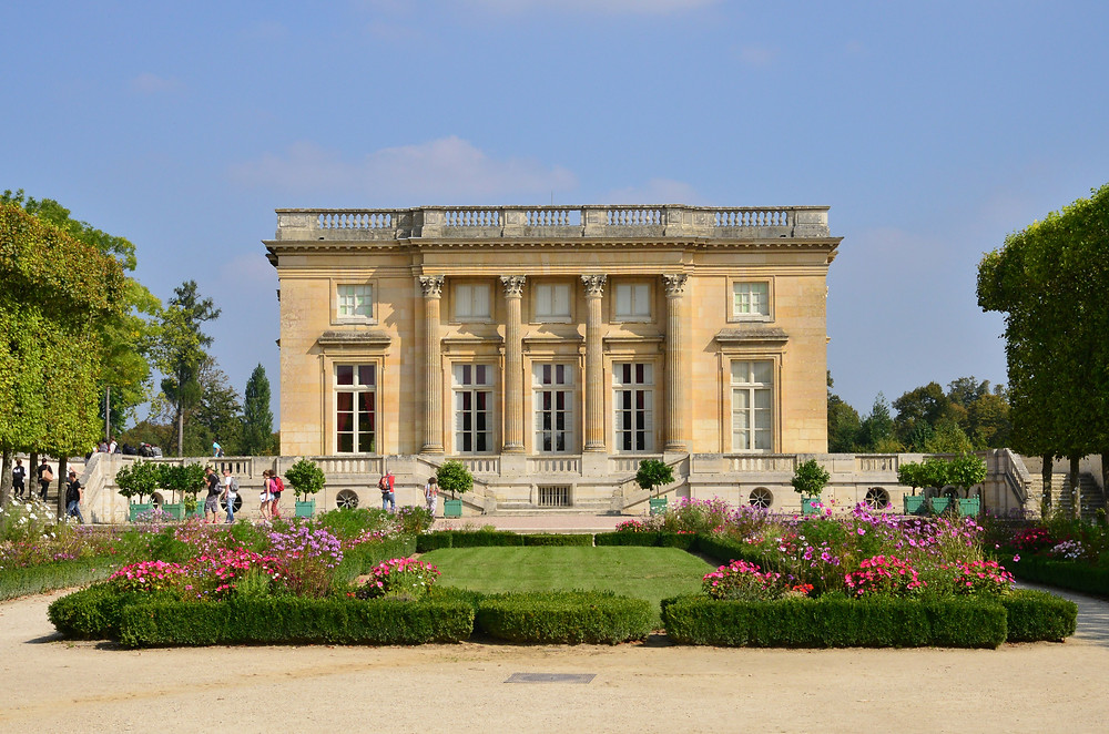 the Neoclassical limestone facade of the Petit Trianon at Versailles