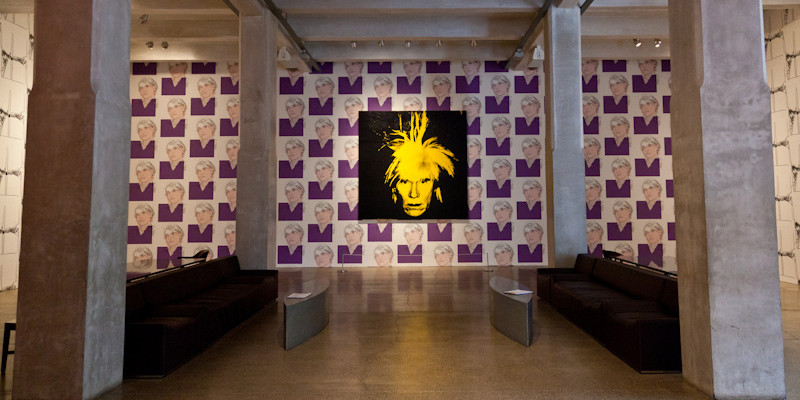 in the center, Andy Warhol's Self -Portrait from 1986