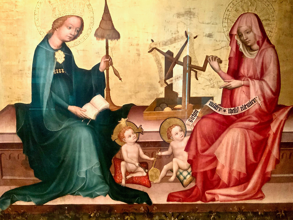 baby Christ and baby John struggle over a small pan, very odd topic for a medieval painting