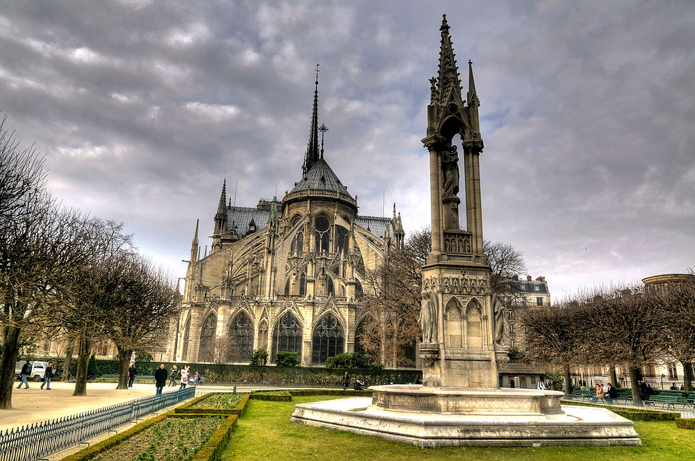 the rear facade and garden of Notre Dame in Paris