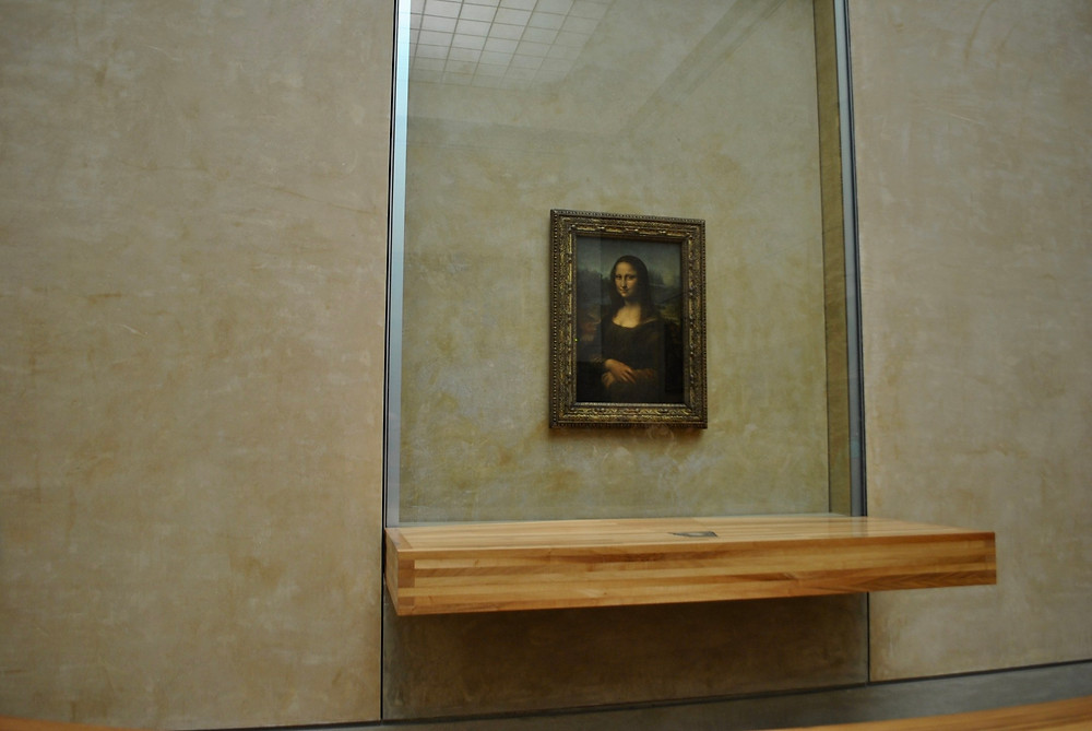 the frequently vandalized Mona Lisa, now behind bulletproof glass