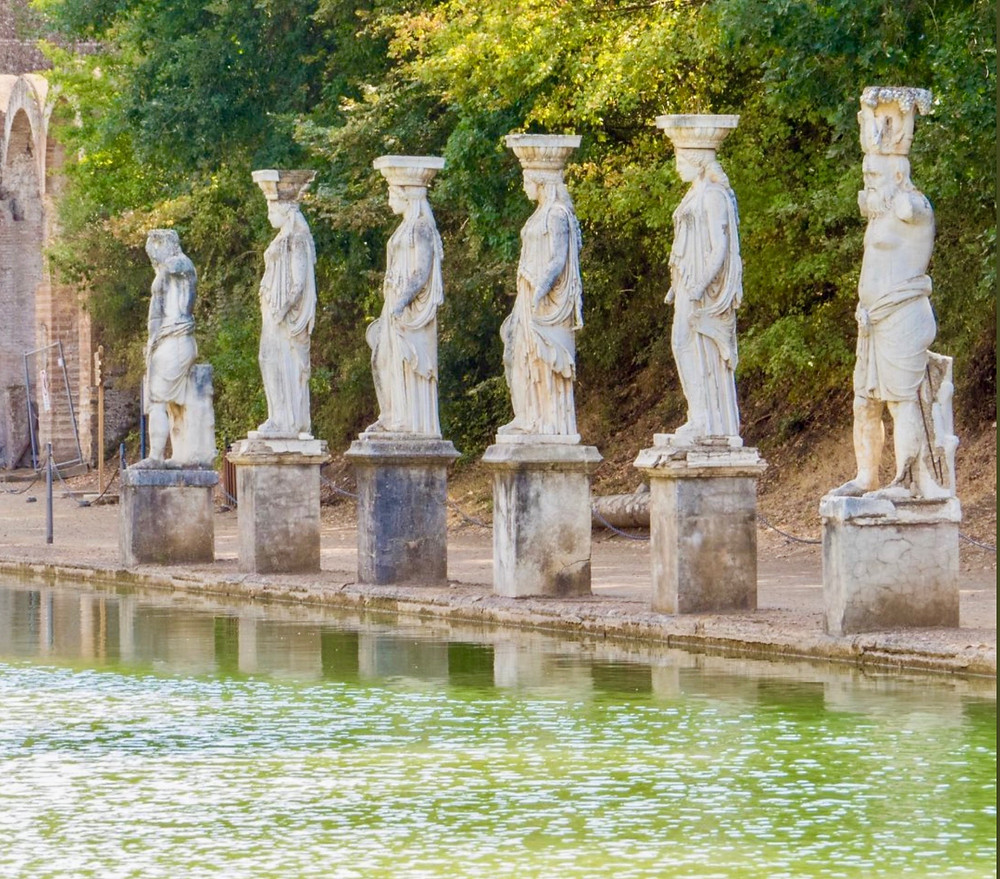 statues lining the pool of the Canopus
