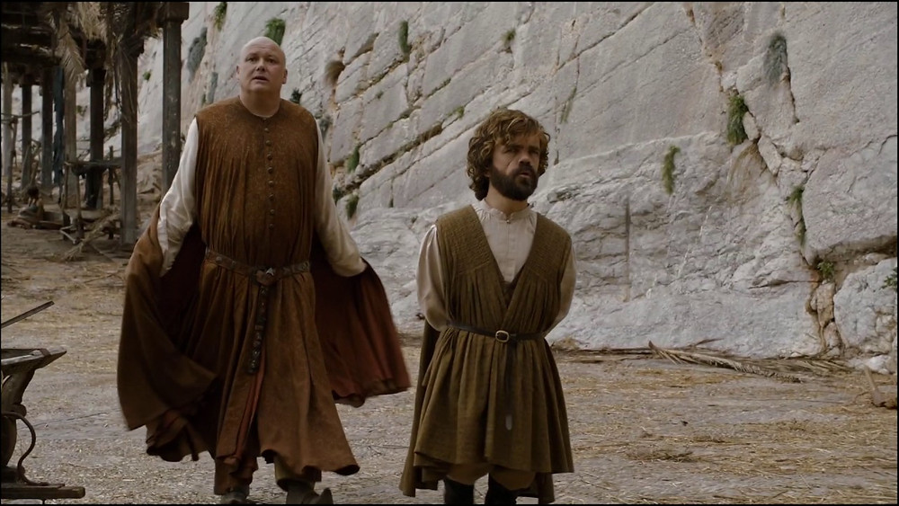 Varys and Tyrion walk through the streets of Mereen, aka Klis Fortress
