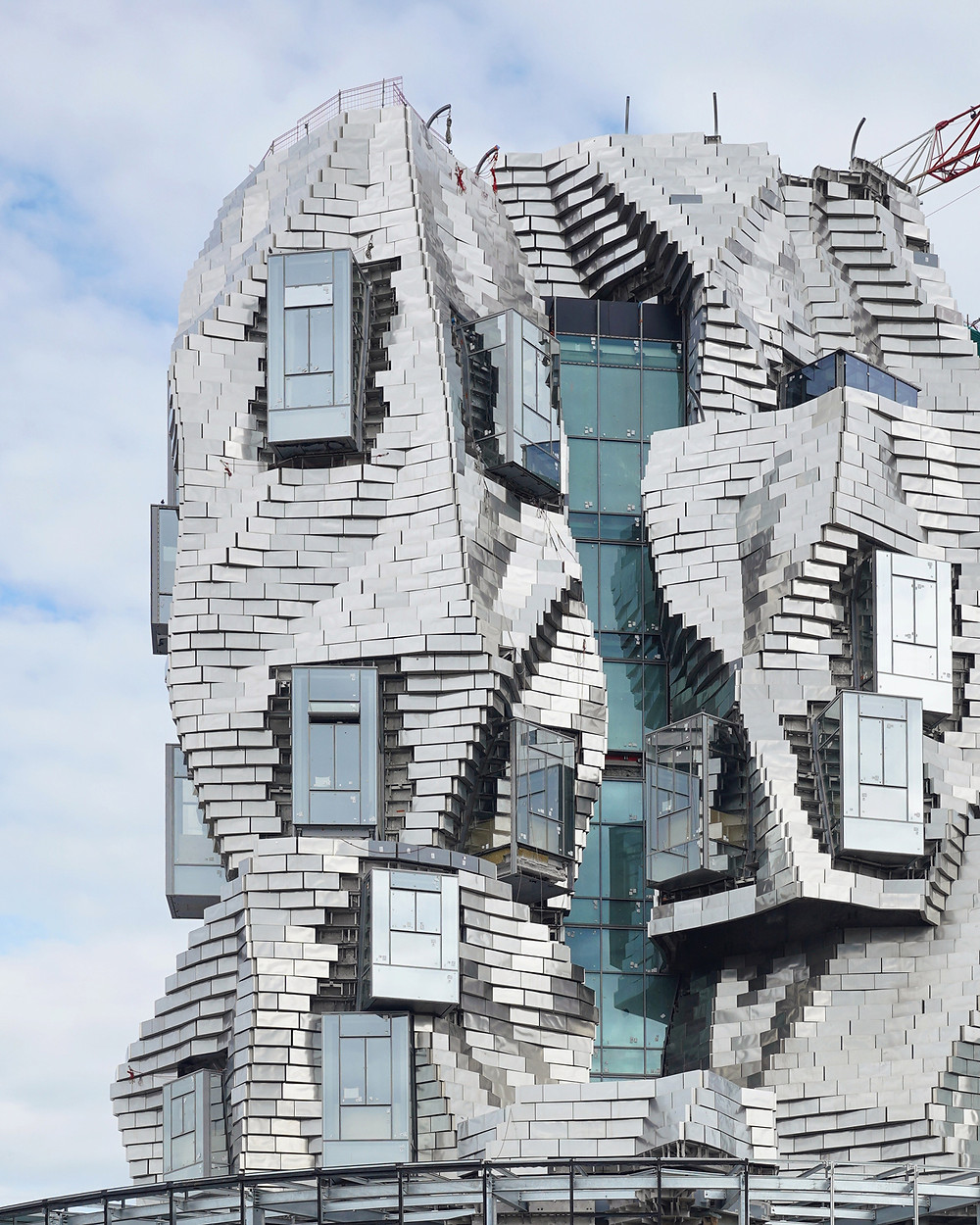 Luma Arles, a twisting tower of reflective aluminum in Arles France. Gehry's design is supposed to mimic the craggy rock formation outside the city that entranced Van Gogh.