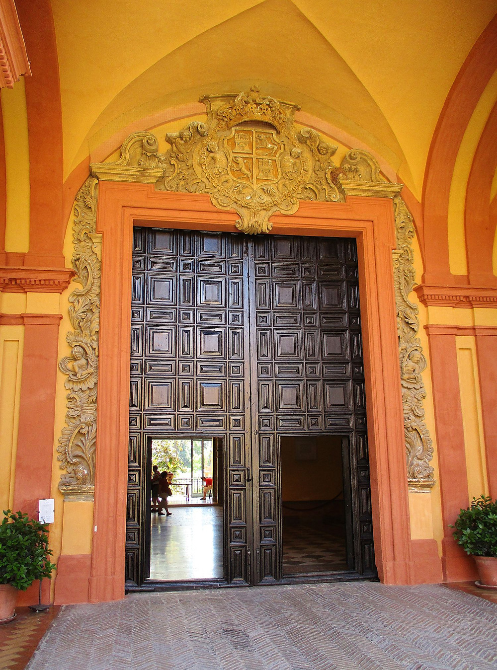 a baroque door in the Alcazar that is the entrance to the Gothic Palace