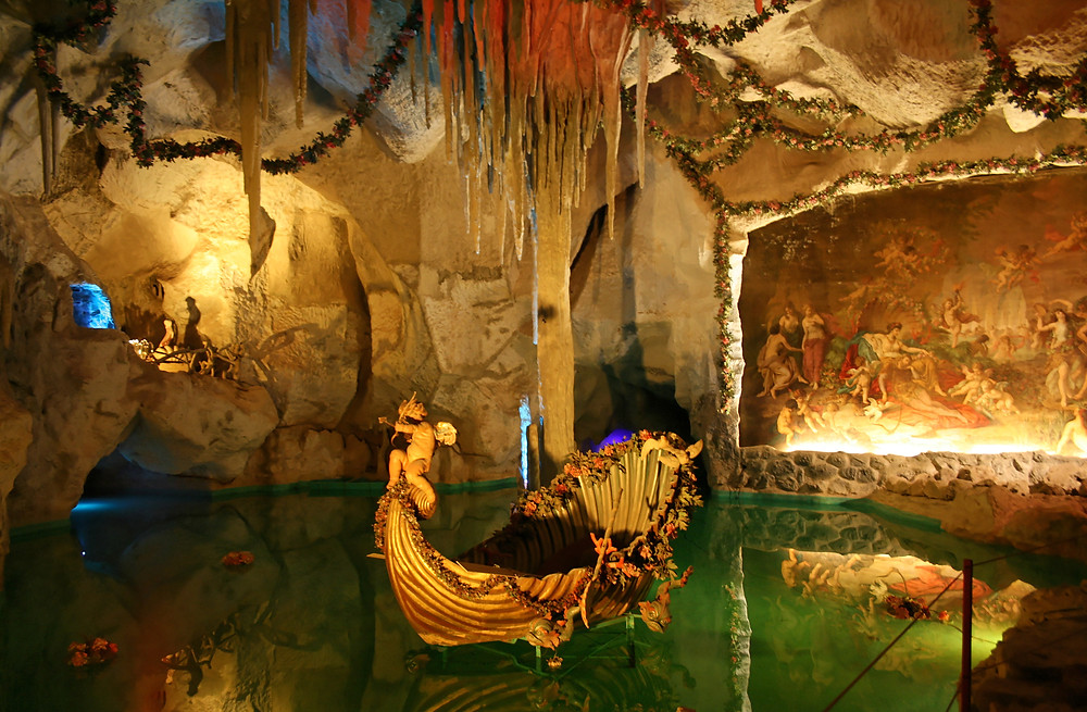 the Venus Grotto at Linderhof with artificial stalactites and a clamshell boat in a faux lake