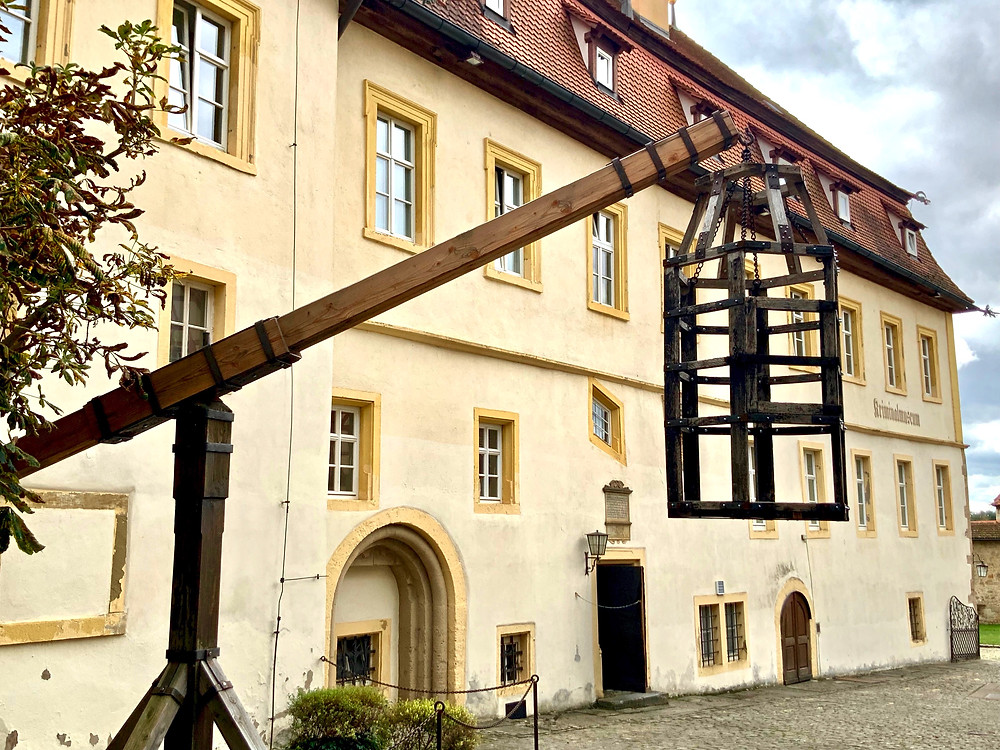 entrance to Rothenburg's medieval crime museum, with a prisoner cage to start the gruesome tour