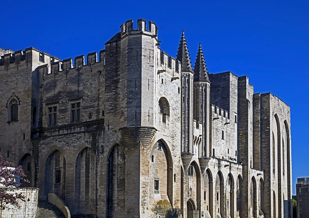 the forbidding Gothic exterior of the Pope's Palace in Avignon