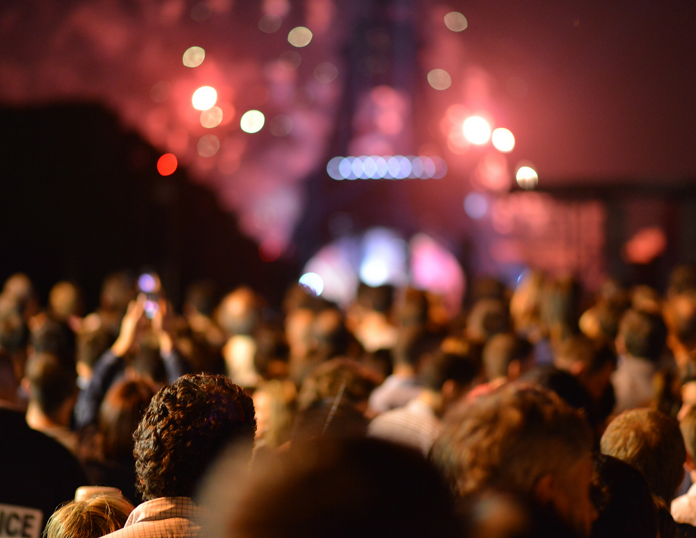 crowds at the Eiffel Tower at night