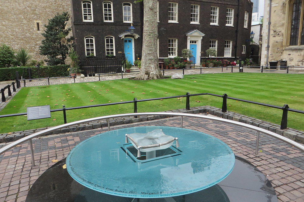 This glass sculpture marks the site of the Tower's inner scaffold, where the axe fell on Tudor queens and bishops.